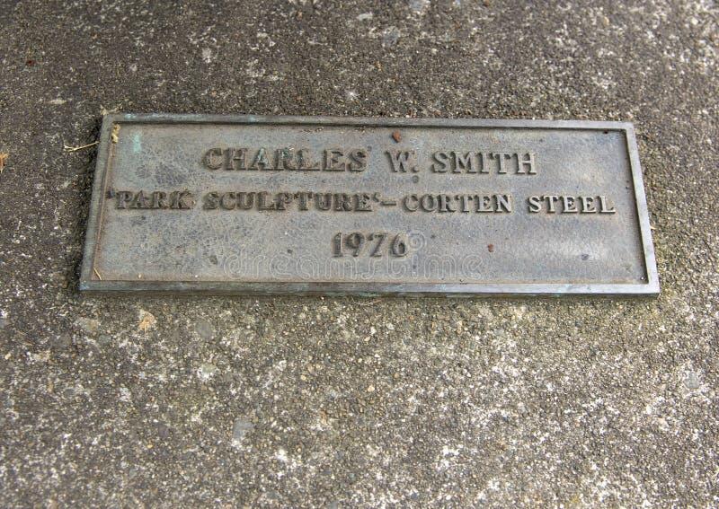 Chapa da informação para o ` da escultura do parque do ` por Charles W Smith, Seattle, Washington imagem de stock