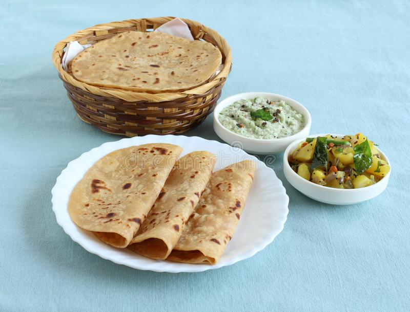 Chapati Indian Food on a Plate and in a Basket royalty free stock photography