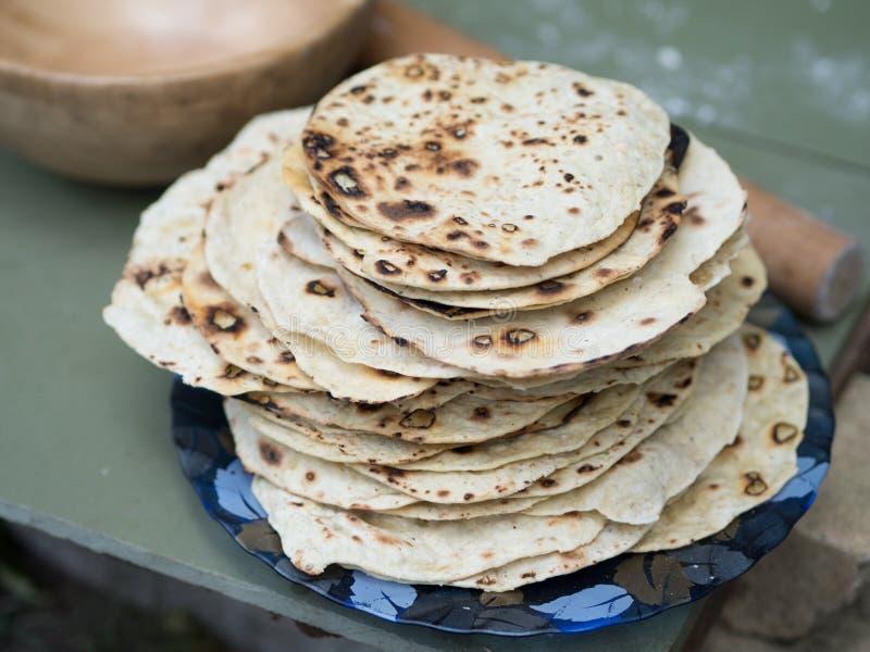 chapati Produkte gemacht vom Mehl Gekocht auf Wasser Auf einem offenen Feuer Mit dem Zusatz von Gewürzen und von Salz Ungesäuerte stockbild