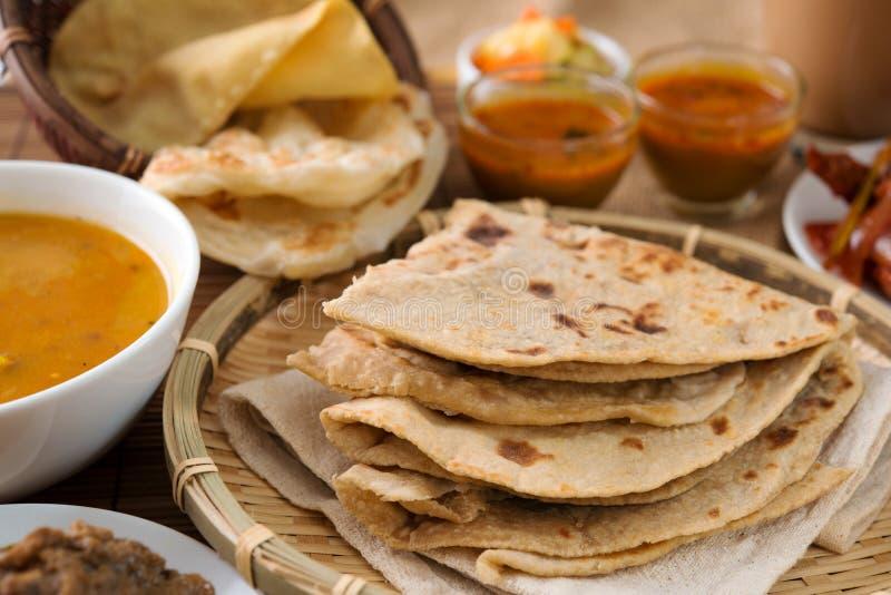 Chapati and roti canai. Chapati or Flat bread, roti canai, Indian food, made from wheat flour dough. Roti canai and curry stock image