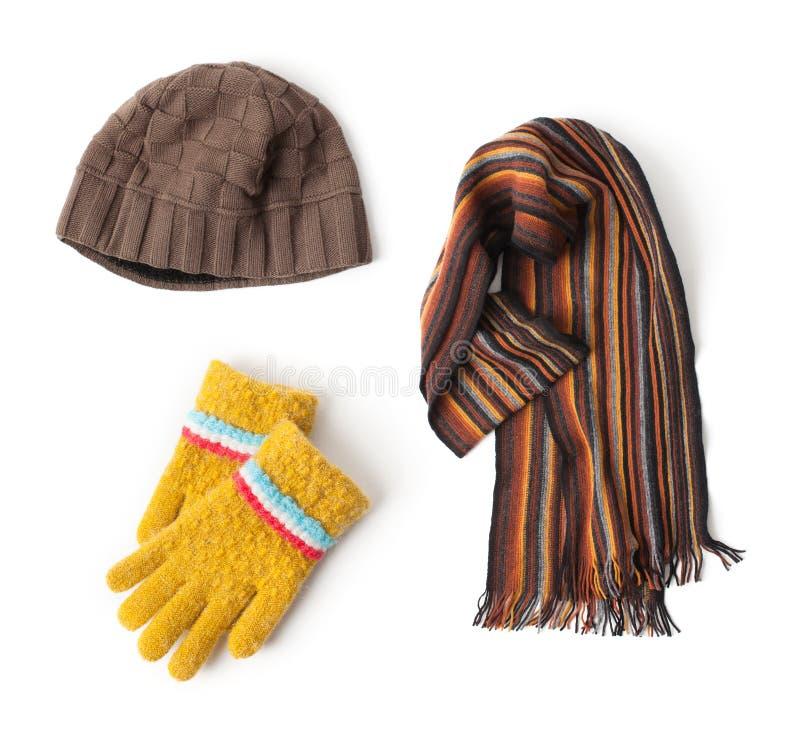 Chapeau, écharpe et gants sur le fond blanc photos libres de droits