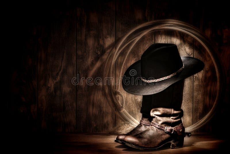 Chapeau de cowboy occidental américain de rodéo sur les gaines et le lasso photos libres de droits