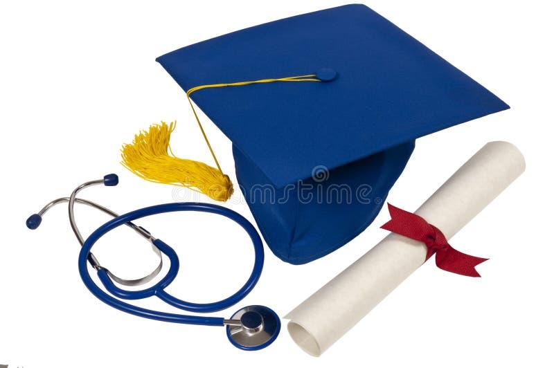 Chapeau de graduation avec le stéthoscope et le diplôme images libres de droits