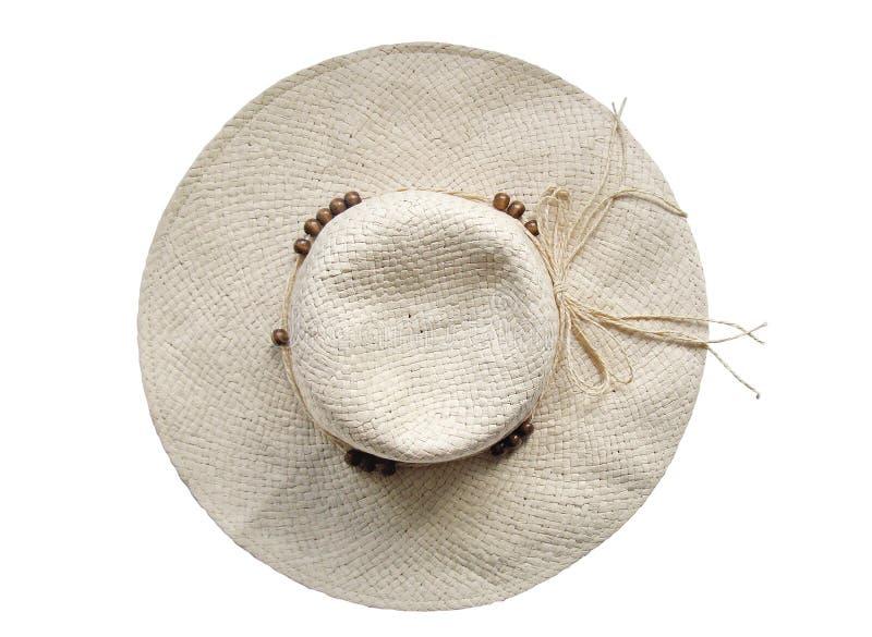 Chapeau de paille d'été sur le fond blanc - première vue photographie stock libre de droits