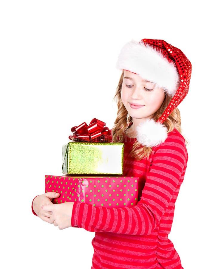 Chapeau de port de l'adolescence de Santa tenant des cadeaux de Noël image stock
