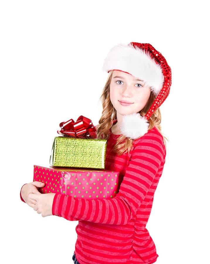 Chapeau de port de l'adolescence de Santa tenant des cadeaux de Noël photographie stock libre de droits