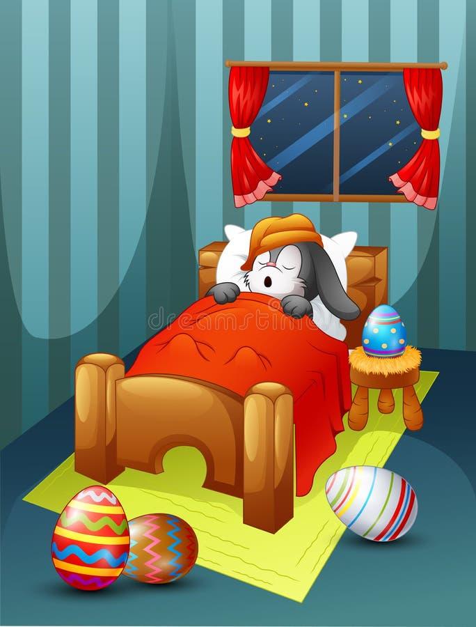 Chapeau de port de lapin de Pâques dormant dans le lit avec des oeufs de pâques illustration libre de droits