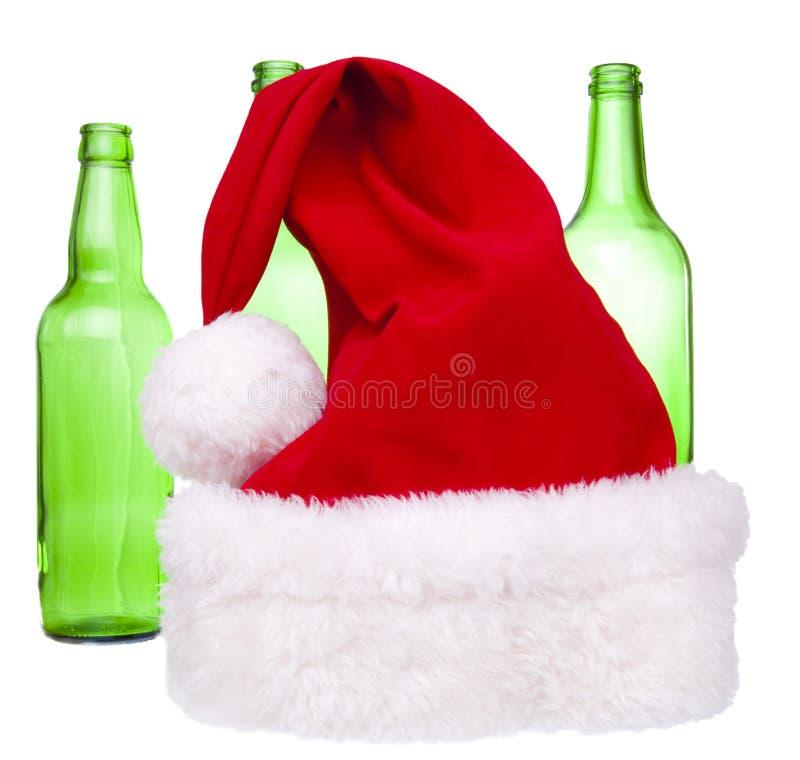 Chapeau de Santa et une bouteille photographie stock libre de droits