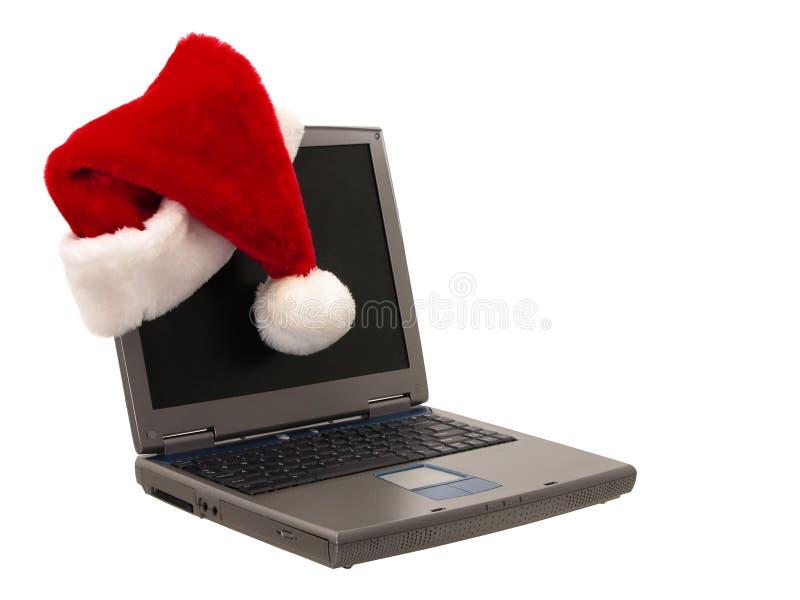 Chapeau de Santa se reposant sur un ordinateur portatif (2 de 3) photos stock