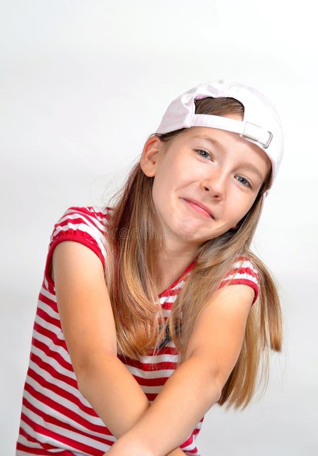 Chapeau drôle de visage de fille images stock