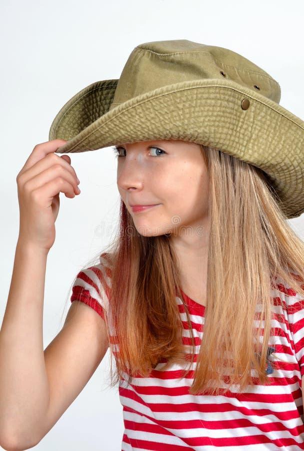 Chapeau drôle de visage de fille photo stock