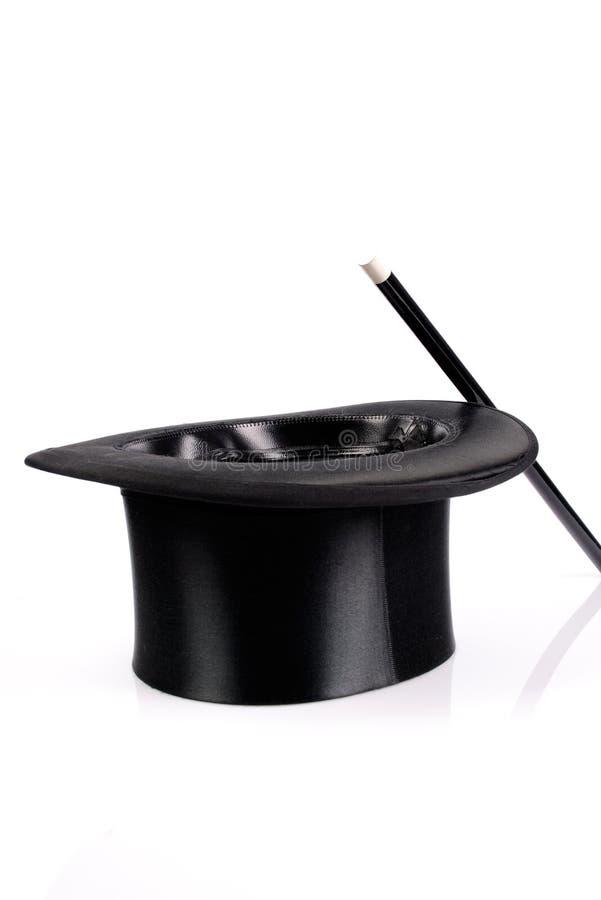 Chapeau et baguette magique magiques images stock