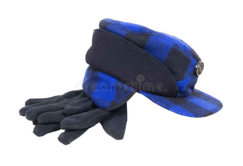Chapeau et gants bleus de chasseurs de plaid photo stock