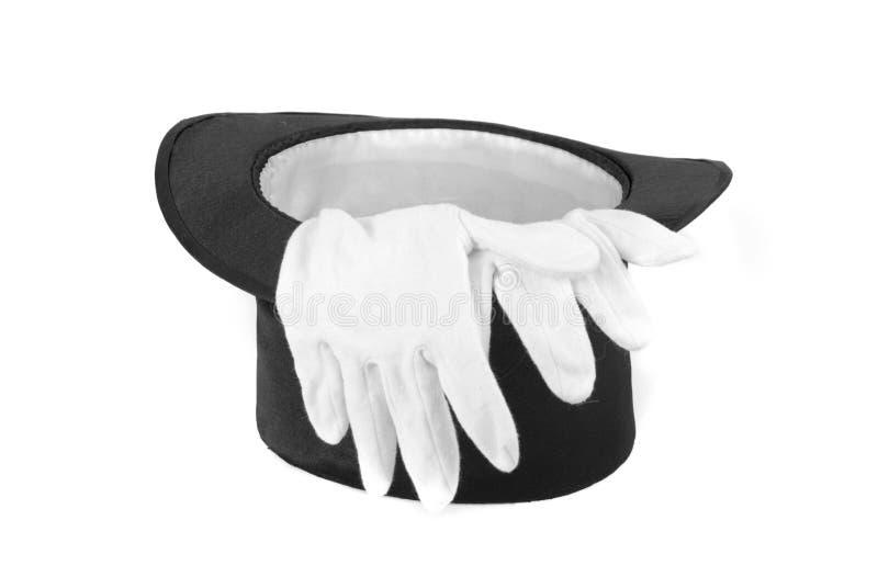 Chapeau et gants de magie noire photographie stock
