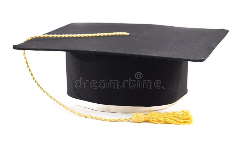 Chapeau noir d'obtention du diplôme d'isolement sur le blanc photos stock