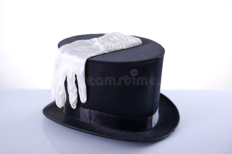 Chapeau supérieur noir avec les gants blancs en soie image stock