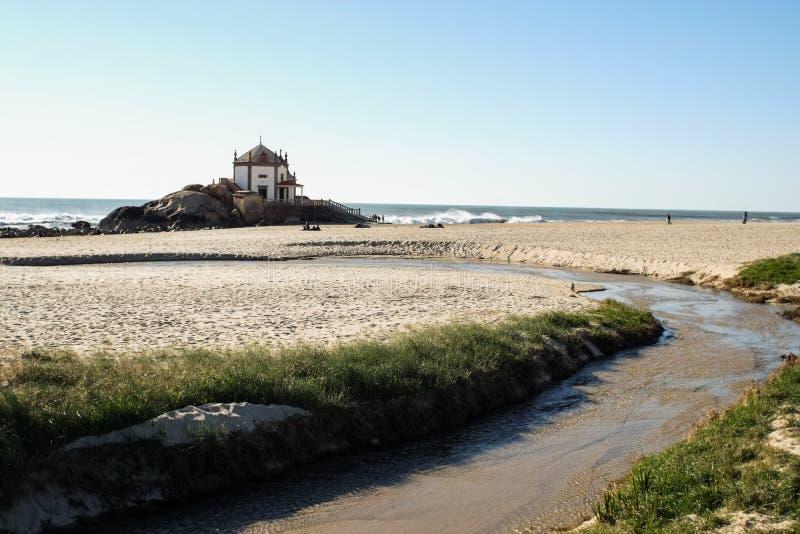 Chapel on the beach in Miramar - Chapel of Senhor da Pedra stock images