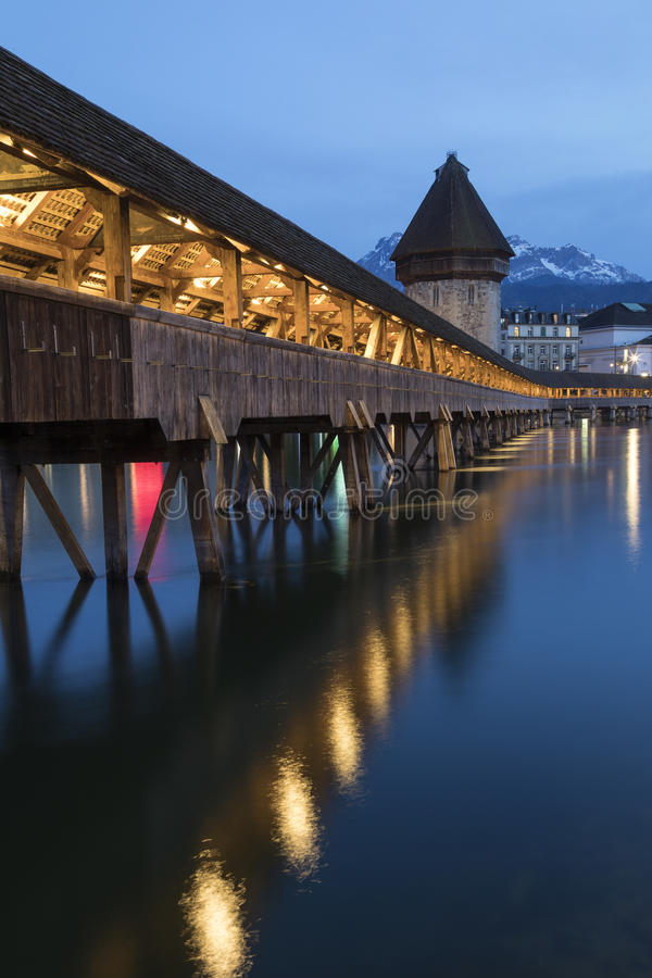 Chapel Bridge - Lucerne - Switzerland. Chapel Bridge & x28;Kapellbrucke& x29; - a 14th century covered wooden footbridge that spans the Reuss in the city of stock image