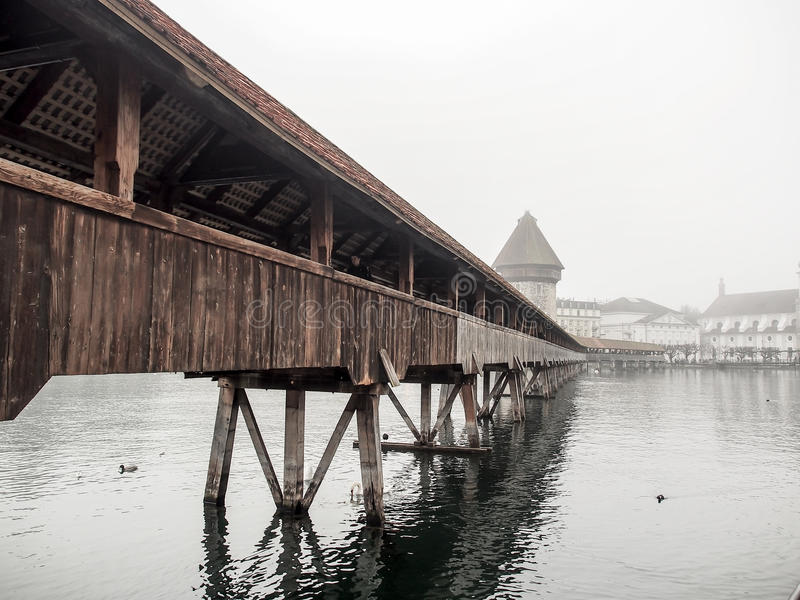 Chapel bridge, in the mist and cloudy sky stock image