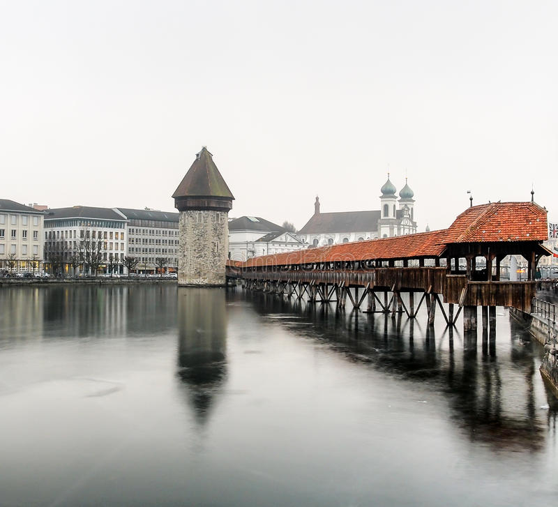 Chapel bridge, in the mist and cloudy sky royalty free stock photo