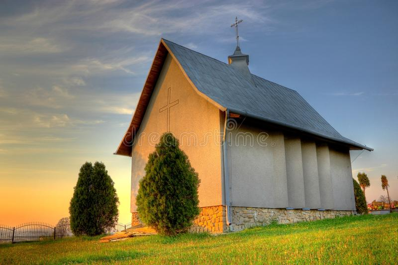 Chapel at evening light. Small catholic chapel on a cemetery at warm evening light royalty free stock photos