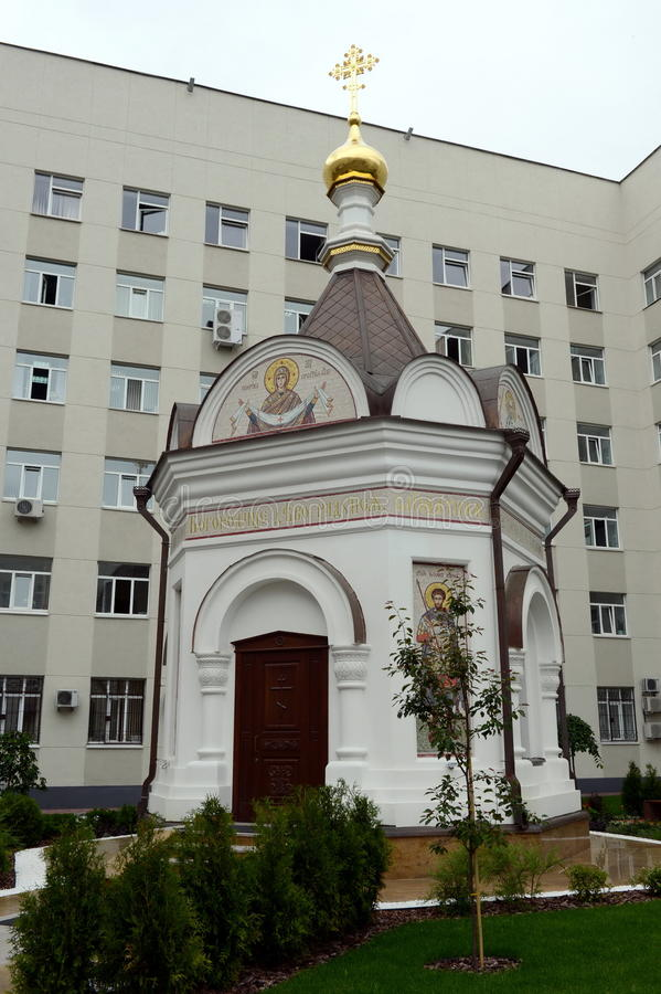 Chapel in honor of the Protection of the Holy Virgin near the police building of Nizhny Novgorod region. NIZHNY NOVGOROD, RUSSIA - JUNE 30, 2015:Chapel in honor royalty free stock image