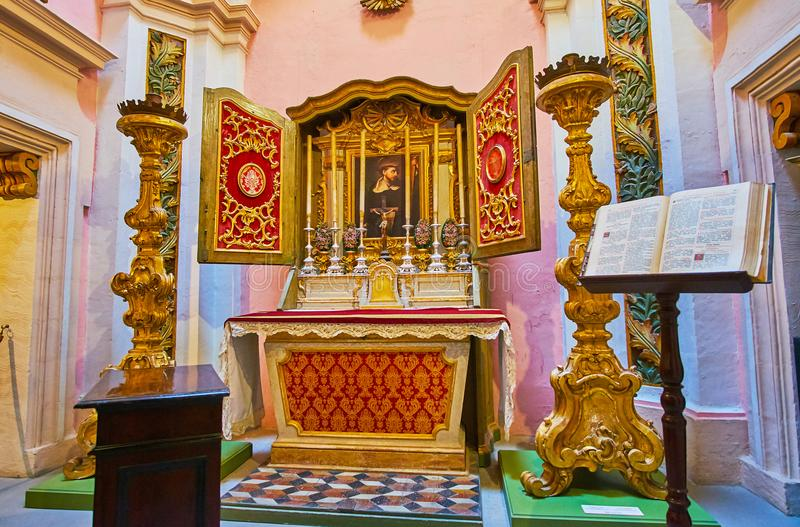 The Chapel of Inquisitor`s Palace, Birgu, Malta. BIRGU, MALTA - JUNE 17, 2018: The prayer hall of the chapel in Inquisitor`s Sacred Palace with carved altar with stock images
