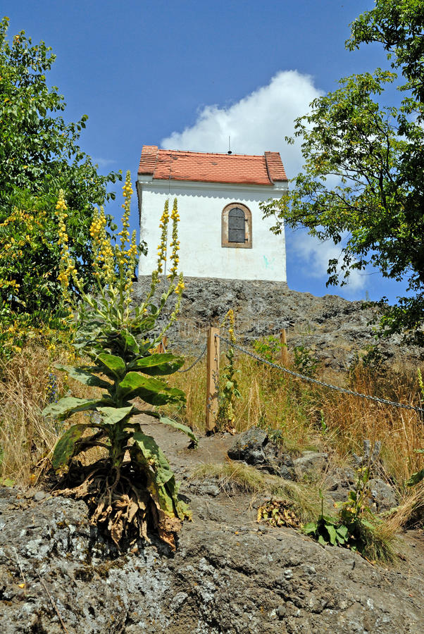 Chapel at the peak of Zebin. The Baroque-style chapel of St. Mary Magdalene is situated on conic basalt hill Zebin (399 m) cca 2 km south-west of Jicin, Czech stock image
