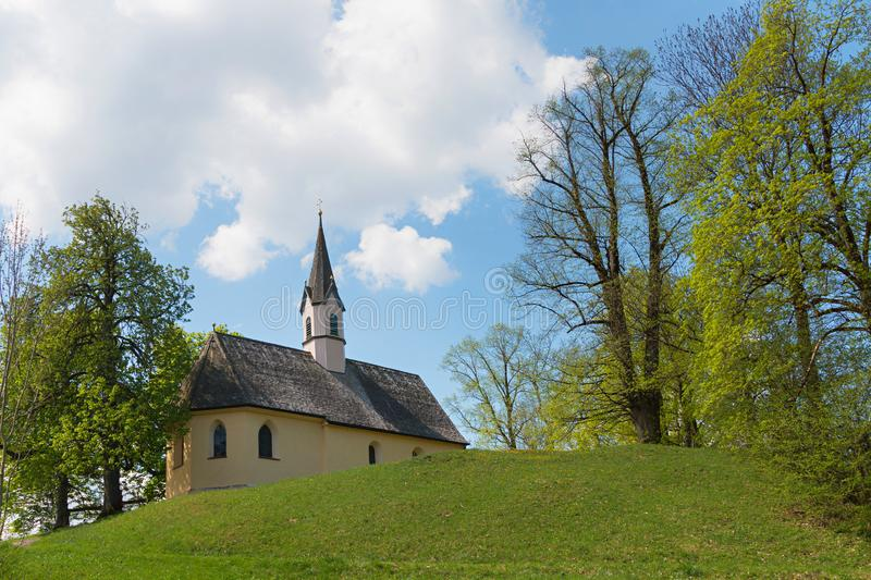 Chapel saint georg at weinberg hill schliersee. In spring, idyllic bavarian landscape and historic building stock photos