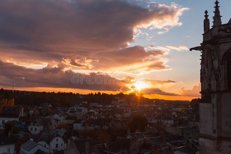 Chapel of Saint-Hubert silhouette at sunset. Chapel of Saint-Hubert silhouette and sunset in the old town of Amboise located in the Indre-et-Loire department of royalty free stock photos