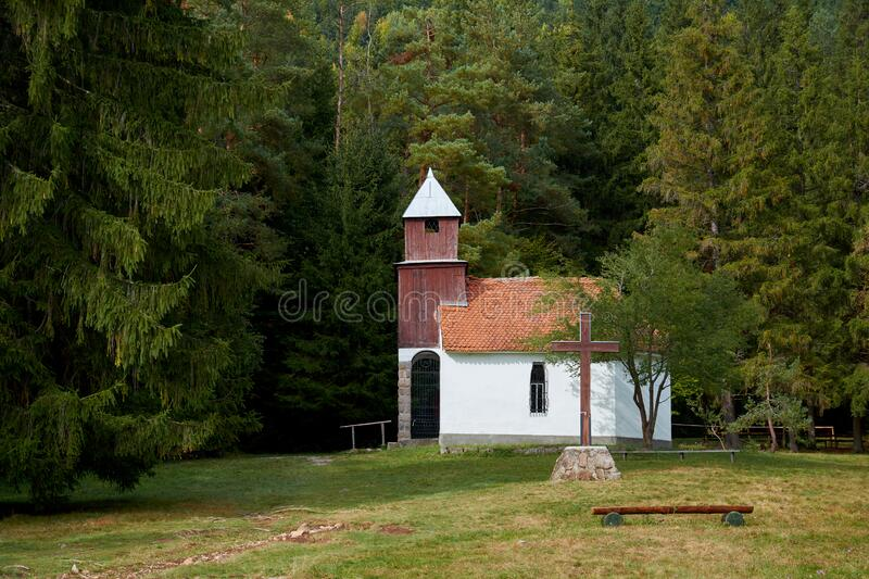 Chapel of St. Anne located in the volcanic crater, near the Lake St. Anne in the forest, Romania. royalty free stock photo