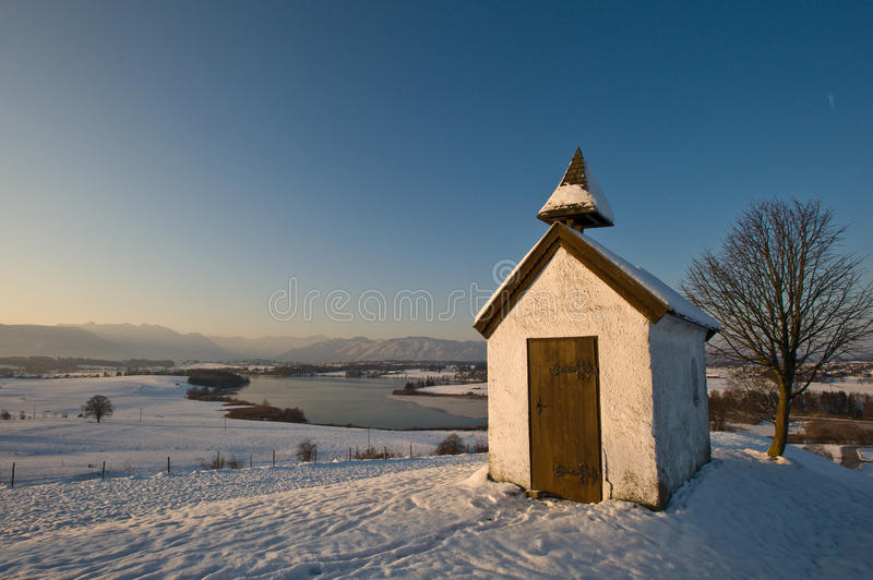 Chapel in Wintry landscape royalty free stock photography