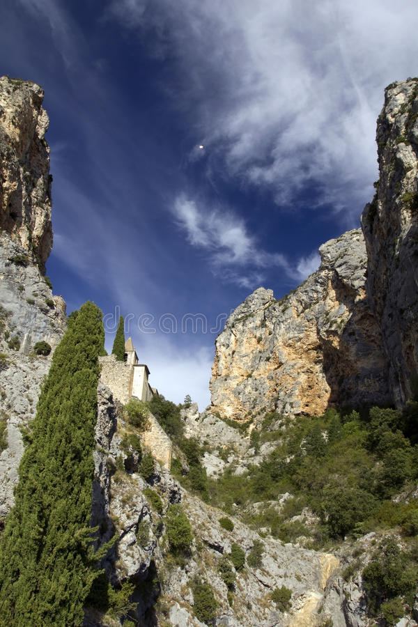 Chapelle Sainte Anne set between the two mountains, Moistiers Sainte Marie, Verdon, France royalty free stock photography