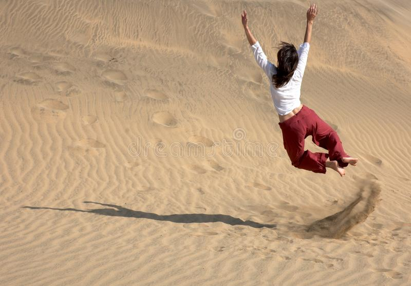Chaplin jumping in the dunes stock image