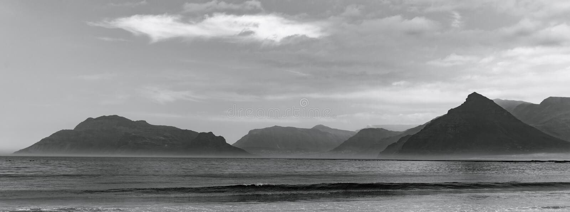 Kommetjie Beach. Chapman`s peak seen from Kommetjie Beach, near Cape Town South Africa royalty free stock photo
