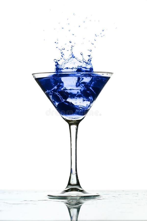 Chapoteo de cristal de Martini foto de archivo libre de regalías