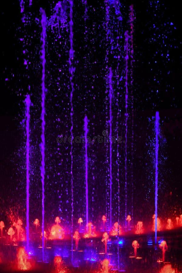 Chapoteo del agua - color de neón fotos de archivo libres de regalías
