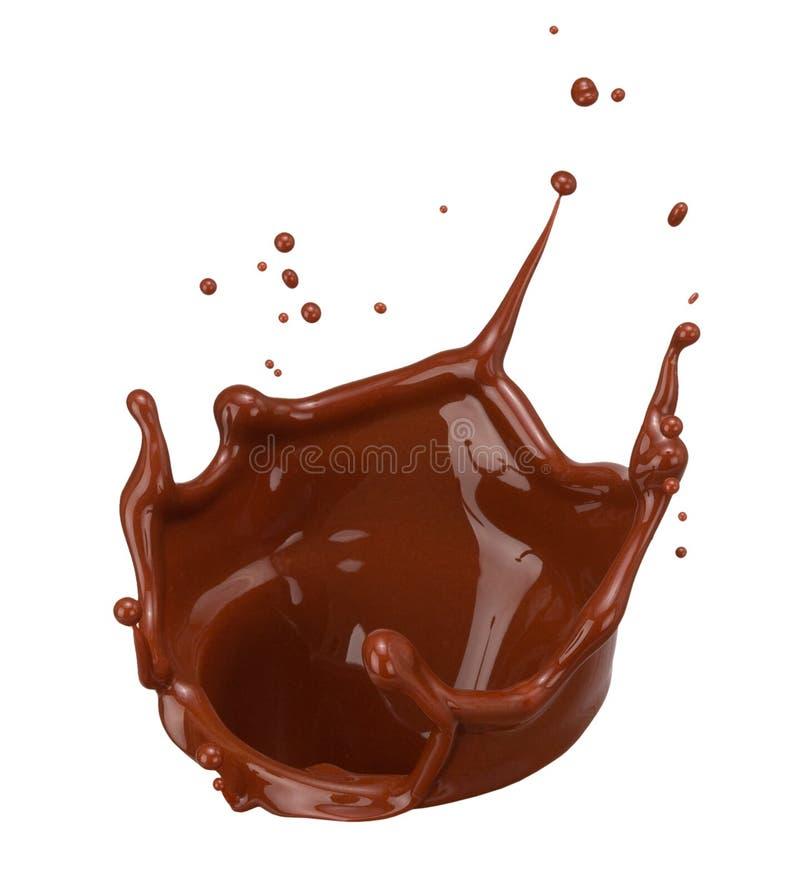 Chapoteo del chocolate aislado en un fondo blanco imagen de archivo libre de regalías