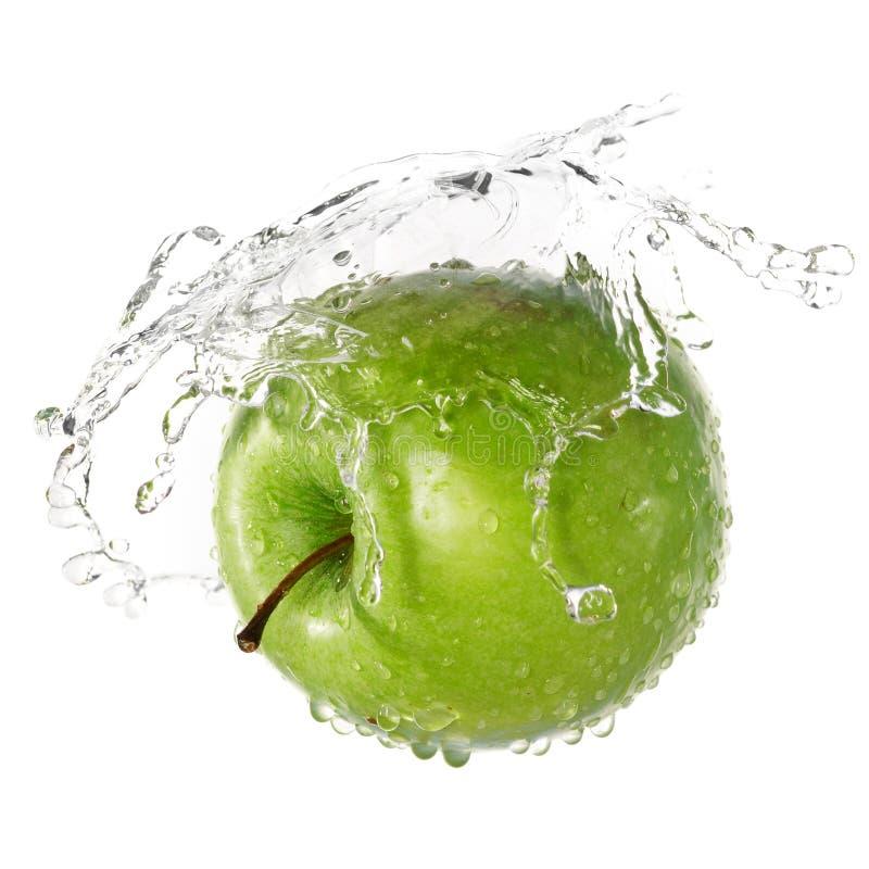 Chapoteo verde de la manzana imagen de archivo libre de regalías