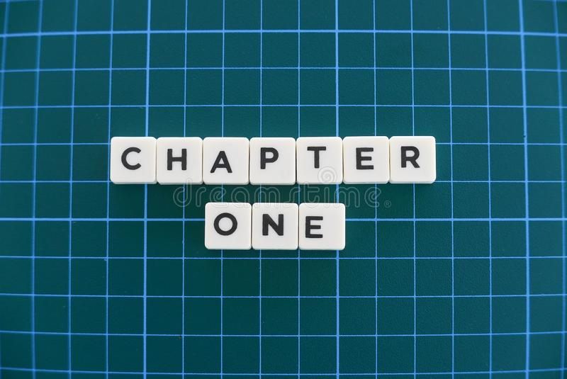Chapter one word made of square letter word on green square mat background stock photography