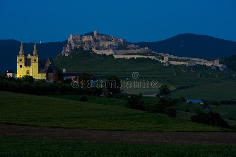 Chapter Spisska and Spissky Castle at night, Slovakia. Outdoor, outdoors, outside, exterior, exteriors, europe, central, republic, czechoslovakia, hrad stock photo