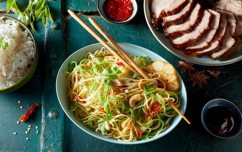Char siu marinated spicy pork with roasted noodles royalty free stock image