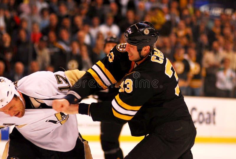 Chara lands a right. Boston Bruins captain Zdeno Chara lands a righthand on Pittsburgh Penguins forward Michael Rupp stock photo