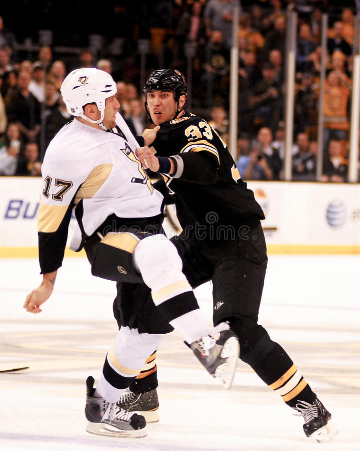 Chara and Mike Rupp fight. Bruins defenseman Zdeno Chara (33) punches Penguins forward Mike Rupp (17 stock images