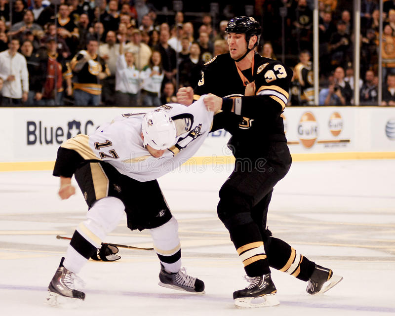 Chara and Mike Rupp fight. Bruins defenseman Zdeno Chara (33) punches Penguins forward Mike Rupp (17 royalty free stock image