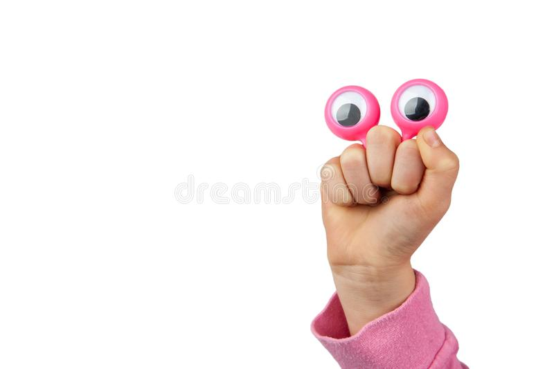 Character depiced with googly eyes and childs hand. Funny amused character depiced with googly eyes and childs hand isolated on white background with copy space stock photos