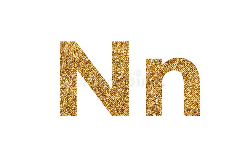 Character N. English alphabet. Isolated on white background. Character N. Letters and Numbers from golden grains of sand. English alphabet. Isolated on white stock images