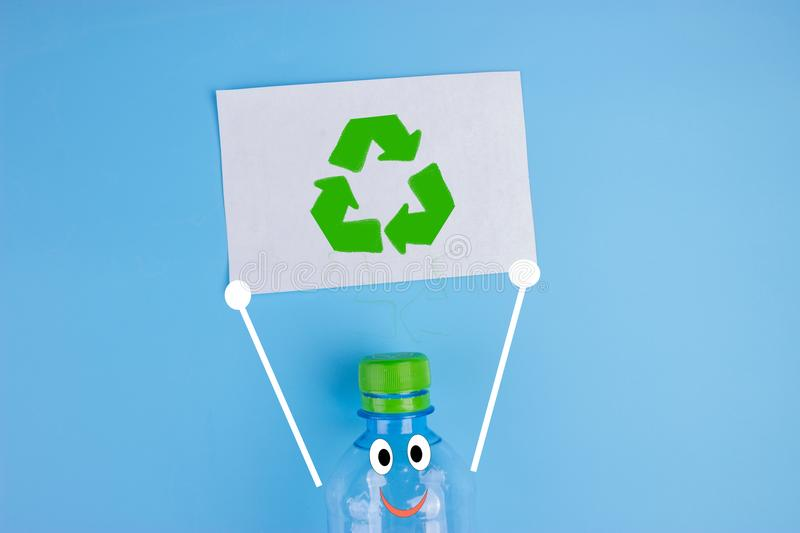 Character plastic bottle with poster. Recycle concept stock photo