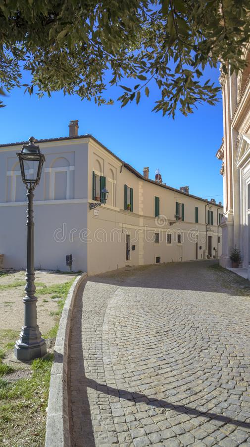 Characteristic alley of Italian village with cobblestone street and lamppost. Amelia, Umbria, Italy stock photos