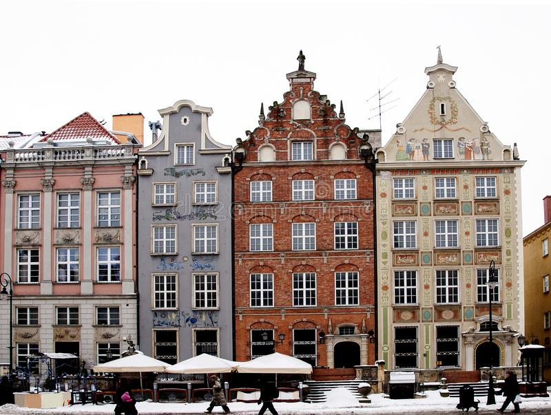 Characteristic facade of buildings in Town of Gdansk. The snapshot of buildings in town of Gdansk with different colors and a lot of windows royalty free stock images